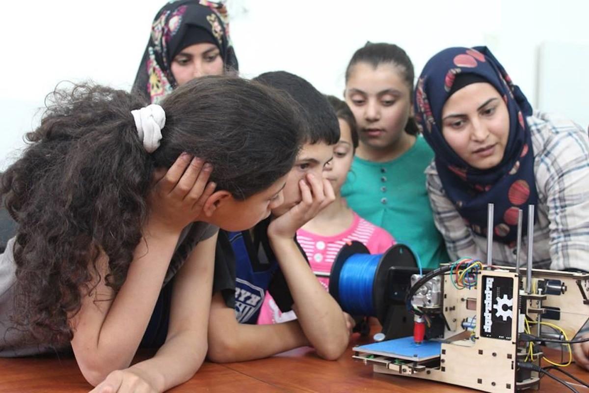 Kids gather around the 3d printer